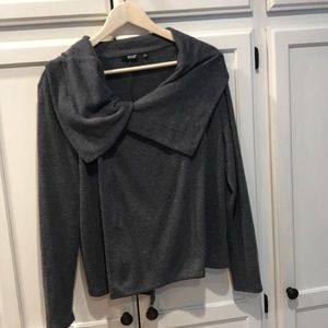 A New Approach a.n.a. L offset zip up sweater.